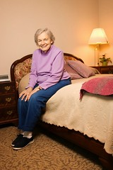 Stock Images (perfectionistreviews) Tags: color indoors retirementhome aging mature adult woman female elderly bedroom portrait smiling vertical senior person assistedliving 80plusadult onepersononly elderlywoman fulllegnth looking eyecontact posed caucasian senioradult photograph smile seniorcitizen household