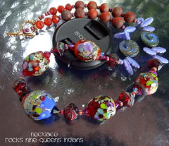 Necklace Rocks Nine Queens Indians (Laura Blanck Openstudio) Tags: openstudio openstudiobeads murano glass jewelry handmade beaded lampwork beads fine arts art artisan artist made usa pendant colorful multicolor whimsical funky odd abstract asymmetric earthy organic one kind rocks nuggets pebbles stones contemporary urban bronce clasp artistic czech swarovski crystals shiny red blue periwinkle black orange burgundy coral green aqua turquoise ocher lime chartreuse raku frit mauve wine bordeaux orchid grape lila lavender violet purple daggers