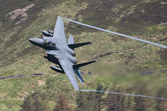 F-15E Strike Eagle Low Level in Wales (Peter Starling) Tags: machloop machynlleth peterstarling flying lowlevel corris corner low vapor vapour mountain trees f15 f15e cadair idris liberty wing 012004 usafe lakenheath ln