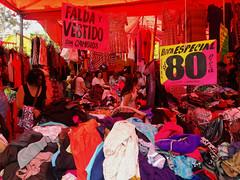Paca (Evelio AD) Tags: tianguis colores multitud paca cdmx mex méxico ropa precios carteles luces rostros mujeres red pink rojo