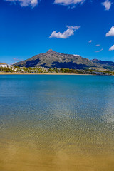 Cast your eye (JKmedia) Tags: spain 2018 boultonphotography marbella mountain mountains water sea beach calm blue sky clouds mediterranean med