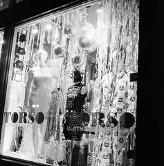 Torso's Holiday Window, Columbus Ohio (ryanungeronline) Tags: 2016 shortnorthcolumbus bw bwnegative blackandwhite rolleiflex28e hp5 iso1600 filmphotography