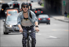 Cyclist on Bank Street (Dan Dewan) Tags: 2018 canonef70200mmf14lisusm dandewan bicycle bankstreet street people person canon colour cyclist ottawa sunday woman ontario canada glasses may portrait lady