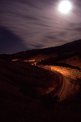 Full Moon on the Railroad (Ray C. Lewis) Tags: moon union pacific railroad train bealville mojave sub tehachapi railroads night freight transportation timeexposure time lapse clouds