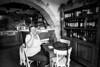 La padrona (SLpixeLS) Tags: italy italie tuscany toscane toscana chianti blackandwhite noiretblanc art volpaia restaurant barucci portrait people personne woman femme boss padrona