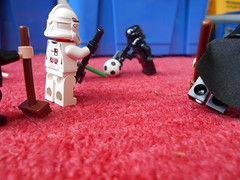 DSCN1136 (classroomcamera) Tags: school classroom floor floors carpet carpets rug rugs red blue star wars lego legography pose poses posing action scene scenes soccer ball balls game games stick sticks stormtroopers batman stormtrooper cape capes mermaid mermaids foreground background play plays playing broom brooms