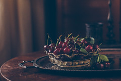 Cherries (Inka56) Tags: stilllife classic cherries bokeh woodtable glassbowl flickrfriday silverplate throughherlens vintage