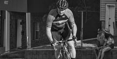 Determination (clarkcg photography) Tags: bike bicycle race racer man helmet bikerace tulsatough riverside tulsa crybabyhill blackandwhite blackwhite bw portrait