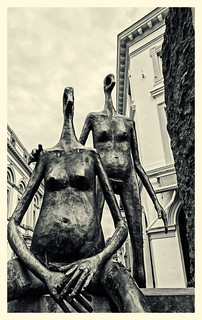The Repose Sculptures - A Bruges Street  (Monochrome - Tinted) (Fujifilm X70 Trans-X Compact with 21mm Converter Lens)
