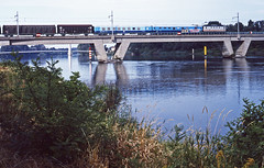 SNCF BB8134 with a Le Tiel-Portes yard transfer freight. Crossing the River Rhone at La Voulte with diverse wagons including two heavily vandalised 'France Telecom' coaches. 2August1999 (mikul44171) Tags: diffus mixedfreight ardeche rhone lavoulte francetelecom fretsncf letiel portes valence