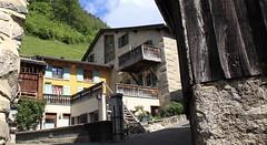 Place de la Fontaine, Mex (bulbocode909) Tags: valais suisse mex montagnes nature villages maisons granges fontaines nuages forêts murs vert bleu jaune printemps escaliers balcons