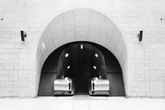 Terra Nullius (Douguerreotype) Tags: monochrome underground city bw station uk metro arch escalator british england tunnel blackandwhite mono subway architecture britain london symmetry gb wall urban tube