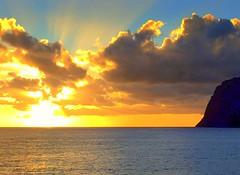 Madeira Sunset (dimaruss34) Tags: newyork brooklyn dmitriyfomenko image sky clouds portugal madeira svetlanafomenko ocean sunset cliff horizon reflection sunrays funchal