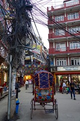 Rikshaw in the centre of Thamel (The Advocacy Project) Tags: nepal kathmandu rickshaw thamel cables chaos tourist