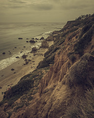 A view of El Matador beach, in Malibu, California, from up the hills. (pedferr) Tags: horizon sunny sand color cinematic nature water surf moody hill sea morning unitedstatesofamerica beach ocean outdoors pacific dramatic stone lines usa landscape sunset waves cloudy sky vertical trip grass texture swell sunrise clouds summer scene urban warm shapes travel rocks pattern 4x5 lifestyle california diagonal malibu mountain