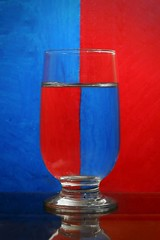Refraction. (Iftekhar Hasan) Tags: refraction red blue glass illusion iftekharhasan water contrast composition symmetry
