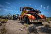 Lanfair Road, Mojave National Preserve, California (paccode) Tags: wreck mojave sand desert truck brush quiet tire california abandoned tires d850 dump forgotten creepy antique colorful nationalpark bushes unitedstates us
