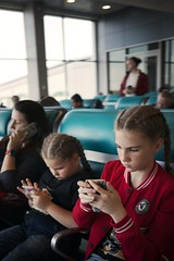 interested in the world around... (f_lynx) Tags: sonya9 sonyfe282 domodedovo moscow russia airport kid kids girl girls phone fun flynx crowd shadows waiting 2x3 hand hands window seat street face faces portrait