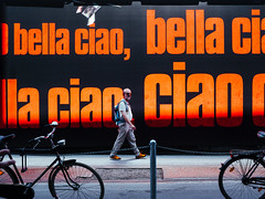 bella.ciao (grizzleur) Tags: color street streetphotography humanelement type typography bold eyecontact orange colormatch shoes guy man dude candid candidphotography framed oly olympus olylove leicadgsummilux25f14 olympusomdem5mkii