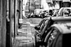 (graveur8x) Tags: woman candid street streetphotography blackandwhite monochrome bw old porto portugal dof look eyecontact curious female contrast warm schwarzweis strase europe canon canoneos5dmarkiv 5d canonef135mmf2lusm 135mm f2 people outdoor outside cars