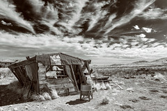 Missing Socks (garshna) Tags: homestead abandoned bw laundry clotheswasher newmexico desert ruins rust sky clouds tarpaper shack lakevalleynewmexico