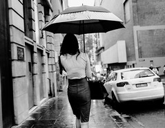 Umbrella Days (McLovin 2.0) Tags: candid portrait street streetphotgraphy urban umbrella rain city melbourne australia bw monochrome bokeh sony rx1 zeiss girls