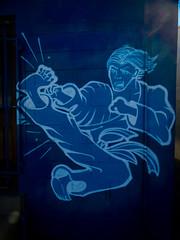 Kung Fu Fighting (Steve Taylor (Photography)) Tags: carldouglas kungfufighting mural streetart blue man newzealand nz southisland canterbury christchurch outline stencil lensflare combat fighting