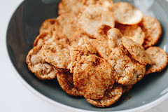Close up of rice cakes with paprika. Rice crackers (wuestenigel) Tags: chip dessert crunchy crisp sweet cracker brown background healthy diet puffed ricecakes delicious macro spicy pile cereal isolated stack white deep asian closeup fried thai tasty crackers nutrition meal rice cookie fresh grain food shrimp bakery cake yellow pastry snack