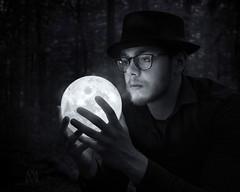 mysterious moon (marianna_a.) Tags: sittingwglases moon light glow man youth hat glasses portrait environmental dark outdoors mariannaarmata glassworks patrick lina
