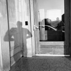 untitled (kaumpphoto) Tags: rolleiflex tlr 120 bw hp5 shadow door window reflection minneapolis car stone wood handel lock corner selfportrait entry entrance