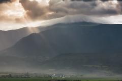 A los pies de Oturia (Alberto Lacasa) Tags: glow rayodeluz rayosunlight mountains niebla lluvia light pirineos sabiñanigo altogallego cultivo huesca campos nubes pyrenees montañas sun fog landescape landscapephotographi rain aragon clouds