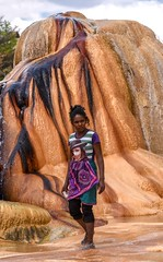 Malagasy Woman and Geyser (Rod Waddington) Tags: africa african afrique afrika madagascar malagasy woman geyser rock water outdoor culture cultural ethnic ethnicity candid nature