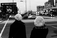 Duet (McLovin 2.0) Tags: candid street streetphotography crochet hat beanie beret winter bokeh night lights dusk streetphoto bw monochrome blackandwhite urban city melbourne australia sony rx1 zeiss