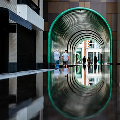Rathbone Square (Sean Batten) Tags: london england unitedkingdom gb rathbonesquare water reflection people green arch nikon df 35mm city urban streetphotography street