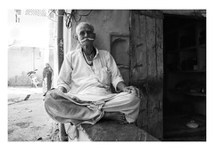 the man, the woman and the onlooker (handheld-films) Tags: india street portrait portraiture man elderly old sitting seated indian blackandwhite mono people travel