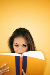 Stock Images (perfectionistreviews) Tags: color indoors youngadult female person vertical portrait book reading study lookingatviewer bookworm studious education filipino women woman 1819years attractive pretty copyspace holding eyecontact peering posed brunette studioshot asian literacy literature oneperson headshot
