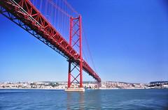 Ponte 25 de Abril (pedrik) Tags: lisbon portugal fm2 nikkoraf24mmf28d fujichromevelvia50rvp film gimp gmic bridge river tagus tejo rio ponte 25deabril alcantara digitizedbyslr 52232018