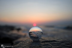 Sunset on the beach, in a crystal ball