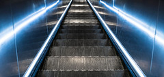 Futur. (Canad Adry) Tags: paris light shadow escalator scale escalier blue color perspective symetry white black strong line sony kit lens e sel1855 1855mm oss zoom af city subway métro street underground