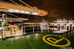 Changing Containers at Midnight (CMA CGM Alexander von Humboldt, Ultra Large Container Vessel) (CMA CGM Alexander von Humboldt) Tags: dockworker bollard poller rotterdam rwg world gate hafen terminal harbour port containervessel containerschiff containership container teu sea meer upperdeck navigation brücke nautical bridge bord boxship freighter big gigant large crew mannschaft schlepper mooring reflection lights spiegelungen panorama view travelling journey northsea nordsee aussicht ausblick perspective outlook weite endlos endless beautiful amazing colour magic awesome maasvlakte gantry crane containerbrücke loading cmacgm rotterdamworldgate cmcgmalexandervonhumboldt change fast motivation work hardwork pressureoftime dunkel night nacht deep