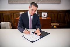 Mayor Garcetti signs the new city budget, with record new investments in the fight against homelessness, and improvements that Angelenos will see and feel in their neighborhoods (Mayor of Los Angeles) Tags: desk office suit citygovernance homelessness