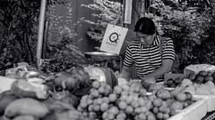Recording Sales (Shane Hebzynski) Tags: bangkok cendor thailand blackandwhite monochrome woman person fruit vegetables city urban