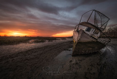 BOGGED DOWN (Stephen Hunt61) Tags: boat mud sunset landscape river tide muddy wreck clouds outdoor icon italy friuli paesaggio marine stefanocaccia