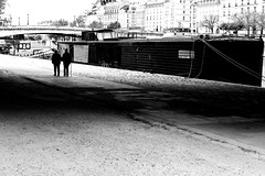 Following the barge (pascalcolin1) Tags: paris13 homme man femme woman quay quais seine barge péniche vieux old photoderue streetview urbanarte noiretblanc blackandwhite photopascalcolin 50mm canon50mm canon