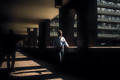 Denim (markfly1) Tags: london city barbican centre man walking through concrete jungle walk silhouetted figure flats pavement low sun early morning shadows bright dark pale blue golden sunrise reflected light windows shapes nikon d750 candid street photography