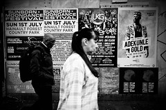 IMG_8181 (JetBlakInk) Tags: subject2ground mono subjecttoground subjecttoback streetphotography advertising billstickers advertisinghoarding concertposters blackandwhite manandwoman