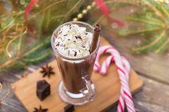 Hot chocolate with whipped cream. Christmas table. (ksenee) Tags: hotchocolate chocolate christmas newyear glass drink winter cold hot cinnamon spice sweet decorative beverage celebration candy cocoa dessert holiday delicious xmas warm whipped cream comfort relaxation festive cane spangle
