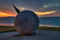 The globe at Portmarnock beach (decovision84) Tags: globe portmarnock sunrise fire sky ireland dublin raw beautiful sculpture design object monument morning sony a6500 18105 photography photoftheday epic irish malahide sun