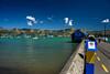 Many Shades of Blue (Jocey K) Tags: crusieships wharf bankspeninsula newzealand nikond750 akaroa hills sea akaroaharbour scene seascape sign clouds sky people boats water