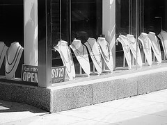 Come In / We're Open (Demmer S) Tags: street streetphotography window windowdisplay jewelry necklaces fashion necklace style retail windowshopping shopwindow displaywindow storewindow shopping storedisplay urbanexploration downtown storefront display business merchandise store shop shootthestreet streetshots documentary urban city outside urbanphotography streetscene outdoors exterior sign type words text word typography signs advertising visual bw monochrome blackwhite blackandwhite blackwhitephotos blackwhitephoto